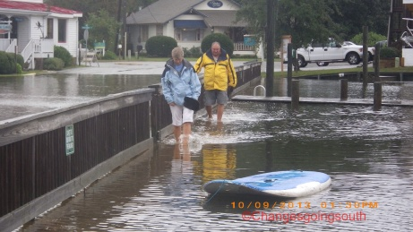 A couple from Catalina 350 walking in flooded area.