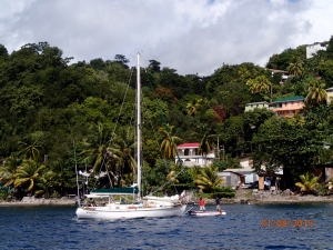 Walkabout with boat boy at their bow in Roseau, Dominica.