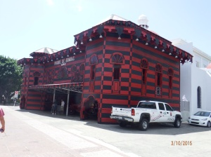 Old Firehouse painted red and black.